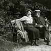 F1951<br /> Jan Adam Charbon en zijn dochter Ida Charbon zittend op een bank in Park Rusthoff achter de gelijknamige buitenplaats aan de Hoofdstraat te Sassenheim. <br /> De foto is afgedrukt op een ansichtkaart, maar wegens het ontbreken van een postzegel en poststempel hoogstwaarschijnlijk persoonlijk op de Hortuslaan bezorgd. De ansichtkaart is geschreven op 18 september 1916 door mejuffrouw Ida Charbon en gericht aan 'Zus Schrama, Sassenheim, Hortuslaan'. De heer Charbon overleed op 12 augustus 1916. Mevrouw Schrama was vele jaren bij de familie Charbon in dienst, o.a. als kinderjuffrouw. Zij werd, zoals vroeger veel gebruikelijk, aangesproken met 'zus'.