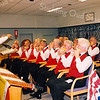 F2559<br /> Een optreden van het Mondorgelvereniging Excelsior in het verzorgingshuis St. Bernardus t.g.v. 15 jaar radio Boterbloem.  Dirigent : Hans van Tol.  Foto: 2003.