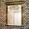 F2450<br /> De namenlijst van de predikanten die in de consistorie van de Ned.-herv. kerk (Dorpskerk) hangt. Foto: 1976.