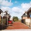 F2094<br /> De ingang van het plan 'Klein Wildrijk'. De huizen in dit plan werden ingevoegd in de nummering van de Hoofdstraat: hier bevinden zich de adressen Hoofdstraat 9, 11, 13 en 15.
