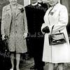 F2242<br /> Pater Wesseling met zijn moeder en rechts juffrouw van W. van der Eerden.
