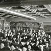 F1393 <br /> Zeer waarschijnlijk is dit een foto van de opening van het bejaardenhuis St. Bernardus op 3 december 1924 (zie zuster met grote kap). Volgens de Leidsche Courant waren hierbij o.a. aanwezig : burgemeester J.P. Gouverneur, pastoor J. Thus, dhr. B. Roest en vele anderen. Rechtsachter (staand) burgemeester J.P. Gouverneur. Links achter hem staat wethouder Hein Bader.