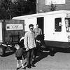Fcs0403<br /> Melkhandel en de zelfbedieningswagen van Arnold van Rijn & Zoon. Zoon Kees van Rijn staat rechts van zijn vader.