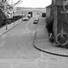 F4246<br /> De ingang van de Wilgenlaan, waar nog maar een paar huizen staan. Later is de Kooiwijk op het leegstaande terrein gebouwd. Op de voorgrond de Rusthofflaan. Foto: ca 1960.