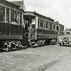 F1041 <br /> De tram met stoomlocomotief. De foto is genomen op de Hoofdstraat ter hoogte van de Molenstraat. Er zijn nog geen elektriciteitspalen te zien. Foto: ca. 1930.