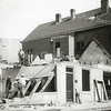 F1058 <br /> De sloop van het oude huis van Vogelaar, Hoofdstraat 209. Rechts het pand van kruidenier Mathôt.  Nu (2016) is hier Intertoys gevestigd. Geheel links de Ned.-hervormde kerk. Foto: 1937.