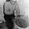 F0715 <br /> Mandenmaker A. Luijk. Het bedrijf heette Mandenmakerij fa. A. Luijk & Zn. in de Floris Schoutenstraat nr. 40. Het bedrijf lag achter het woonhuis. De mand (ter reparatie) is van Bontje. Foto: 1958.