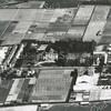 f3479<br /> Een luchtfoto in de omgeving van de Bernardus (in het midden) en de Zuiderstraat (links van de Bernardus).