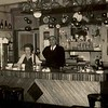 Fcs0533<br /> Hotel-Café-Restaurant 'Rusthof' van dhr. N. van der Putten op Hoofdstraat 179. Het echtpaar van Putten achter de tap.