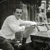 F2698<br /> Tegenover dhr. Blom was de bakkerszaak van Jaap Rhijnsburger. Zijn vader had hier al een bakkerszaak en het bedrijf wordt nu gerund door de zoon van Jaap.