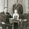F2327<br /> Vier generaties van de fam. Van der Voorn:<br /> V.l.n.r.: Antonius Adrianus (Toon; 15-6-1883), Wilhelmus Adrianus (Wim; 22-9-1910), op het tafeltje Anthonius Bastiaan (Ton; 13-4-1939) en Wilhelmus Arnoldus (12-3-1854).