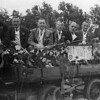 F4045 <br /> Bevrijdingsoptocht, georganiseerd door de Oranjevereniging. De slagers van Sassenheim. Vlnr: Op de bok zit Van der Meij; Gé van der Vliet; Jan van Hage; Jaap Hulsbosch; Scholten; Piet Couvée; Aad Couvée. Foto: 1945