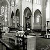 F2268<br /> Het interieur van de St. Pancratiuskerk te Sassenheim. Links loopt dhr. H. van Steijn.
