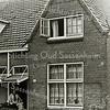 F2232<br /> Josephina Hillegonda Weijers, echtgenote van Arnold van Rijn, staat in deuropening van hun huis in de Kerklaan nr. 45. Nu is dit Kerklaan 63. Foto: 1929.