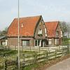 F2183<br /> Panden aan de Wasbeeklaan in Warmond, net onder de A44 door. Beide panden werden vele jaren bewoond door de families Maurits (links) en Van der Kroft (rechts). De huizen zijn gesloopt in 2010 voor de aanleg van het NS-station Sassenheim. Ze stonden tussen de A44 en de Schiphollijn.