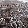 F3604<br /> Luchtfoto. Linksonder de R.K. Pancratiuskerk en rechtsmidden de Dorpskerk (N.H.kerk). Rechtsboven de ruïne van Teijlingen. Foto: voor 1981