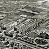 F2932<br /> Een luchtfoto van o.a. de St. Bernardus vlak nadat de bouw gereed was. Duidelijk is te zien de fraai aangelegde tuin erbij. Links vooraan de gebouwen van Baartman en Koning, van van Zonneveld en Philippo en de Zuiderstraat. Helemaal links de in aanbouw zijnde schuur van Bader. Later G.B. de Vroomen