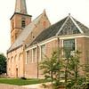 F2434<br /> Ned.-herv. kerk (Dorpskerk),  gebouwd omstreeks 1080, toren 13de eeuw. Grotendeels verwoest in 1574, herbouwd in 1595. Toren gerestaureerd in 1957/58 door de firma De Raat. Het kerkgebouw is gerestaureerd in 1971-1973 onder leiding van architect Van der Sterre. Het oudste tufstenen deel is toen in oorspronkelijke staat teruggebracht met Romaanse ramen. De oude zij-ingang is weer aangebracht. Het lage gedeelte dateert uit de 18de eeuw. Foto: 1976.