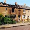 F1111c <br /> Gevolgen van de brand in de Julianalaan nr. 69 op 10 mei 2006.