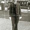 F1940<br /> Leendert van Leeuwen (geb. 16-08-1920) vóór de Hr.Ms. Urania.  Zie ook zijn levensverhaal in het Stratenboek van Sassenheim, pag. 19. Foto 2 sept. 1938.  Zie ook foto's nr. F1936, F1938 en F1941.