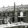 F0531 <br /> Bollenschuur van K. Nieuwenhuis & Co. aan de Rijksstraatweg. Het pand is geheel verwoest tijdens een bombardement; zie beschrijving in 'Tienduizend vreemden over de vloer van H. van Amsterdam'. Nu in 2016 staat er een nieuw bedrijvencomplex. Foto: 1945.