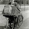 F3580<br /> Jacques van Goeverden op de transportfiets, bestellingen wegbrengen voor klanten van hun kruidenierszaak. Jaques was jarenlang een enthousiast bestuurslid van de Oranjevereniging.