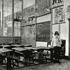 F0437 <br /> Kees Beumer met zijn vaders hoed en pijp in een klaslokaal van de openbare school, waar zijn vader, J. Beumer, schoolhoofd was. Zie ook 'Kent U ze nog ... De Sassenheimers?'  van A.M. Hulkenberg, pag.30. Foto: 1906.