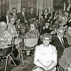 F1986<br /> De foto is genomen in een zaal van de St. Bernardus. Rechts vooraan zit P. Kniest en echtgenote.  Achter het echtpaar Kniest zien we o.a. dhr. Knegt, dhr. Elfering en mevr. Lindaard. In het midden mevr. Verkleij en mevr. Lascaris. Helemaal achteraan dhr. Verkleij. Foto: eind jaren '70.