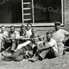 F1155 <br /> In aanbouw zijnde winkel van bakker Oorschot aan de Lindenlaan. Vooraan, liggend met de hoed in de hand, Piet Reeuwijk van aannemersbedrijf Th. Reeuwijk.<br /> V.l.n.r.: onbekend, Arie Eikelenboom (Hoekstraat), J.C. Schrama, E. Waasdorp sr., Arie van der Voet, P. Reeuwijk, Hein Hoogervorst en Siem Eikelenboom.
