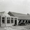 F0841 <br /> Collectie Oudshoorn 070: pakkerij en loods werkplaats van Van Zonneveld & Co, ter hoogte van de Emmalaan.  Op de achtergrond is nog de Julianakerk te zien.<br /> Foto: vóór 1921.