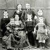 F0632 <br /> Foto van de familie Johannes de Nobel en Tanneke de Kok. Johannes de Nobel was kleermaker in Sassenheim.<br /> 1e rij v.l.n.r.: Marinus, Tanneke de Kok, Cornelis en Grada.<br /> 2e rij: Gerrit Jan, Neeltje, Dirk, Johannes de Nobel.<br /> <br /> Zie 'Genealogie en geschiedenis van het geslacht De Nobel'. Foto: ca 1881.