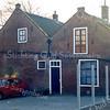 F0137 <br /> Voormalige Chr. Afgescheiden Gemeente (Gereformeerde Kerk), gelegen aan de Hoofdstraat. Rechts de kerkzaal met toegangsdeur. Afgebroken in december 1997.    Foto: 1990. Zie beschrijving F0136, F0138, F0160, F0203, F0213, F0214, F0359.