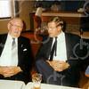 F4555<br /> Twee bestuursleden van de Oranjevereniging Nic. Dofferhof en Gé van Niekerk onder het genot van een glaasje de voortgang van het Oranjefeest bespreken. Foto: jaren '70