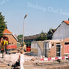 F2546<br /> De hoek van de Van Heemstrastraat en de Zandslootkade, een deel van de Oranjebuurt wordt gesloopt. Foto: 2003.