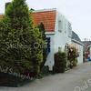 F2022<br /> Deze toegangsweg, gelegen naast het Chinees-Indisch Restaurant 'Peking', Parklaan 144 leidt naar de achterkant van het gebouw 'Immanuel' aan de Meidoornlaan. Foto: 2009