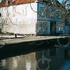F4370<br /> Moskee aan de Vaartkade te Sassenheim. De lege plek op de voorgrond is de plaats waar de Asschuur (gesloopt in 2002) heeft gestaan. Foto: 2002
