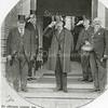 F1185b <br /> De opening van het nieuwe raadhuis op 17 januari 1930 door de Commissaris der Koningin in de Provincie Zuid-Holland, jhr. mr. dr. H. van Karnebeek, te midden van burgemeester en wethouders van Sassenheim. V.l.n.r. wethouder H. Bader, gemeentesecretaris W. Los, Van Karnebeek, wethouder W. Warnaar en burgemeester J.P. Gouverneur.