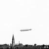 F1455d <br /> De Zeppelin boven Sassenheim ter hoogte van de bollenschuur van Bader (later G.B. de Vroomen). De foto is genomen op 13 oktober 1929.