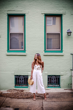 White Jumpsuit Green Wall