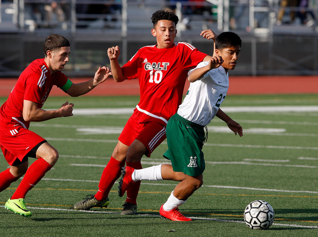. Galt High School\'s Hector Serrato (3) and Adrian Copado (10) battles Alisal High School\'s Joel Garci (22) during their CIF Nor Cal soccer match in Salinas on Tuesday, March 6, 2018.  Alisal High beat Galt High 3-2 to advance to the Nor Cal semifinals.  (Vern Fisher - Monterey Herald)