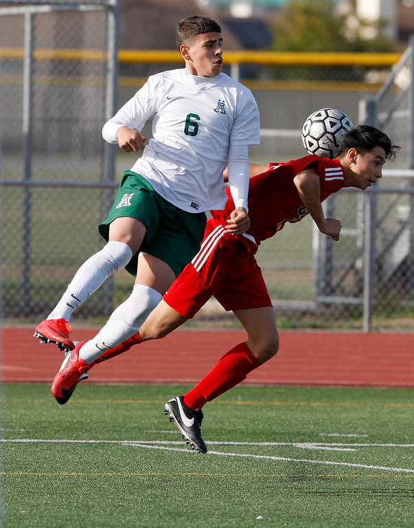 . Alisal High School\'s Angel Amezcua (6) battles Galt High School\'s Alexis Gonzalez (11) during their CIF Nor Cal soccer match in Salinas on Tuesday, March 6, 2018.  Alisal High beat Galt High 3-2 to advance to the Nor Cal semifinals.  (Vern Fisher - Monterey Herald)