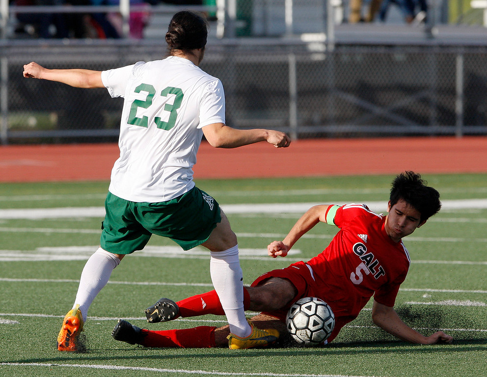 . Alisal High School\'s Carlos Pacheco (23) battles Galt High School\'s Jose Alvarez (5) during their CIF Nor Cal soccer match in Salinas on Tuesday, March 6, 2018.  Alisal High beat Galt High 3-2 to advance to the Nor Cal semifinals.  (Vern Fisher - Monterey Herald)