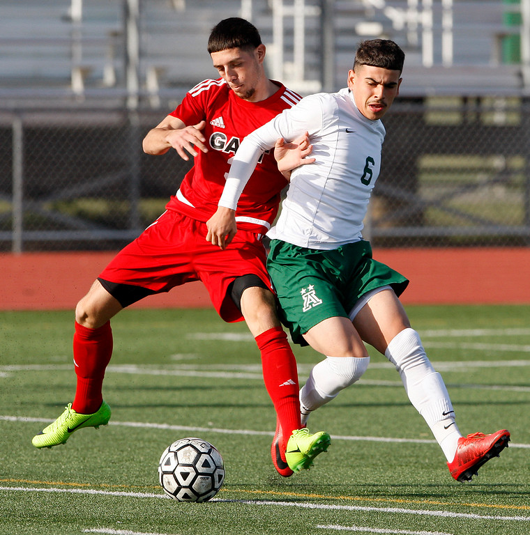 . Galt High School\'s Hector Serrato (3) battles Alisal High School\'s Angel Amezcua (6) during their CIF Nor Cal soccer match in Salinas on Tuesday, March 6, 2018.  Alisal High beat Galt High 3-2 to advance to the Nor Cal semifinals.  (Vern Fisher - Monterey Herald)
