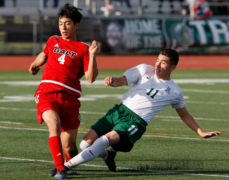 . Galt High School\'s Nathan Villalobos (4) battles Alisal High School\'s Jose Trejo (11) during their CIF Nor Cal soccer match in Salinas on Tuesday, March 6, 2018.  Alisal High beat Galt High 3-2 to advance to the Nor Cal semifinals.  (Vern Fisher - Monterey Herald)