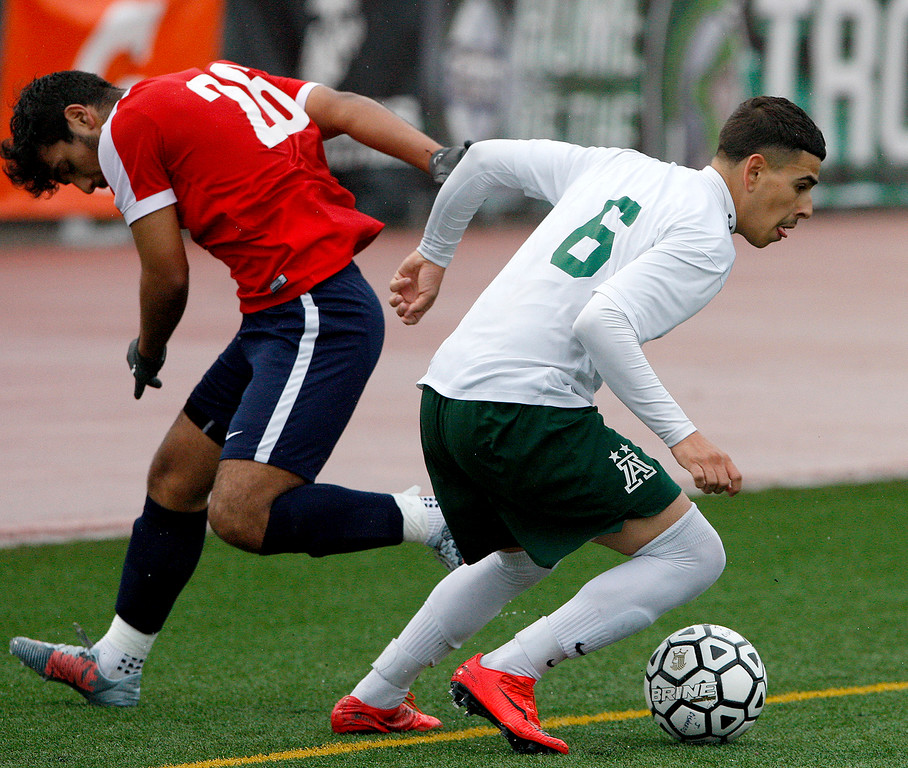 . Alisal High School\'s Angel Amezcua (6) gets past Richmond High School\'s Saul Carapia (26) during their CIF Nor Cal DII Championship match in Salinas on Saturday, March 10, 2018.  Alisal went on to win the Nor Cal DII boys soccer title 3-1.  (Vern Fisher - Monterey Herald)