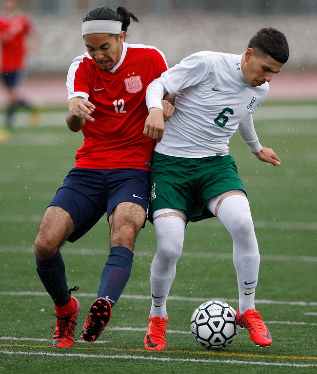 . Richmond High School\'s Francisco Ayala-Cruz (12) battles Alisal High School\'s Angel Amezcua (6) during their CIF Nor Cal DII Championship match in Salinas on Saturday, March 10, 2018.  Alisal went on to win the Nor Cal DII boys soccer title 3-1.  (Vern Fisher - Monterey Herald)