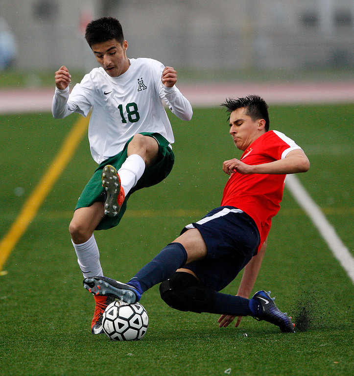 . Alisal High School\'s Julien Peguero (18) avoids Richmond High School\'s Luis Serrano (8) during their CIF Nor Cal DII Championship match in Salinas on Saturday, March 10, 2018.  Alisal went on to win the Nor Cal DII boys soccer title 3-1.  (Vern Fisher - Monterey Herald)