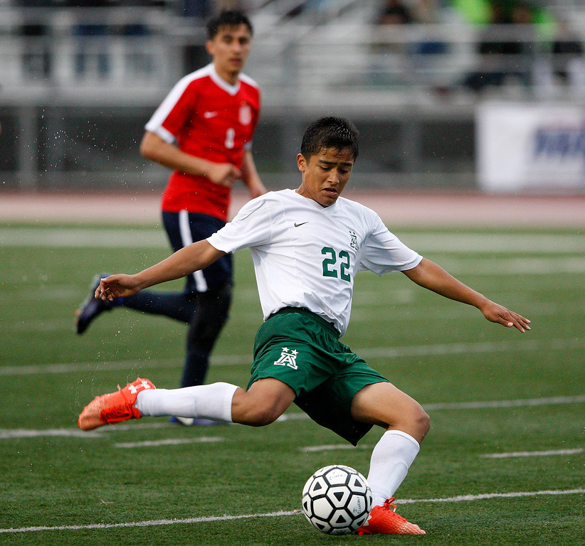 . Alisal High School\'s Joel Garcia (22) takes a shot on goal during theirCIF Nor Cal DII Championship match in Salinas against Richmond High School on Saturday, March 10, 2018.  Alisal went on to win the Nor Cal DII boys soccer title 3-1.  (Vern Fisher - Monterey Herald)