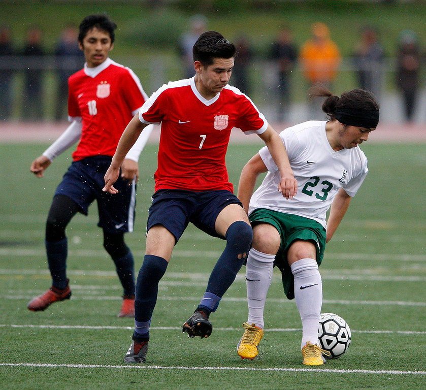 . Richmond High School\'s Octavio Munuz (7) battles Alisal High School\'s Carlos Pacheco (23) during their CIF Nor Cal DII Championship match in Salinas on Saturday, March 10, 2018.  Alisal went on to win the Nor Cal DII boys soccer title 3-1.  (Vern Fisher - Monterey Herald)