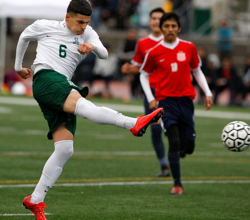 . Alisal High School\'s Angel Amezcua (6) takes a shot on goal against Richmond High School during their CIF Nor Cal DII Championship match in Salinas on Saturday, March 10, 2018.  Alisal went on to win the Nor Cal DII boys soccer title 3-1.  (Vern Fisher - Monterey Herald)